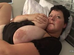 Big titted mama squirts heavily wh