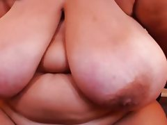 Huge hanging tits on older lady